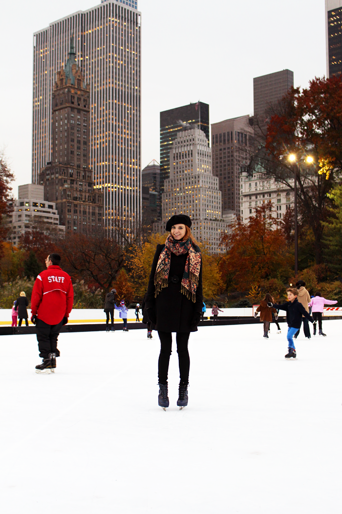 Ice skating in Central Park in fall. Fashion Blogger outfit with a beret.