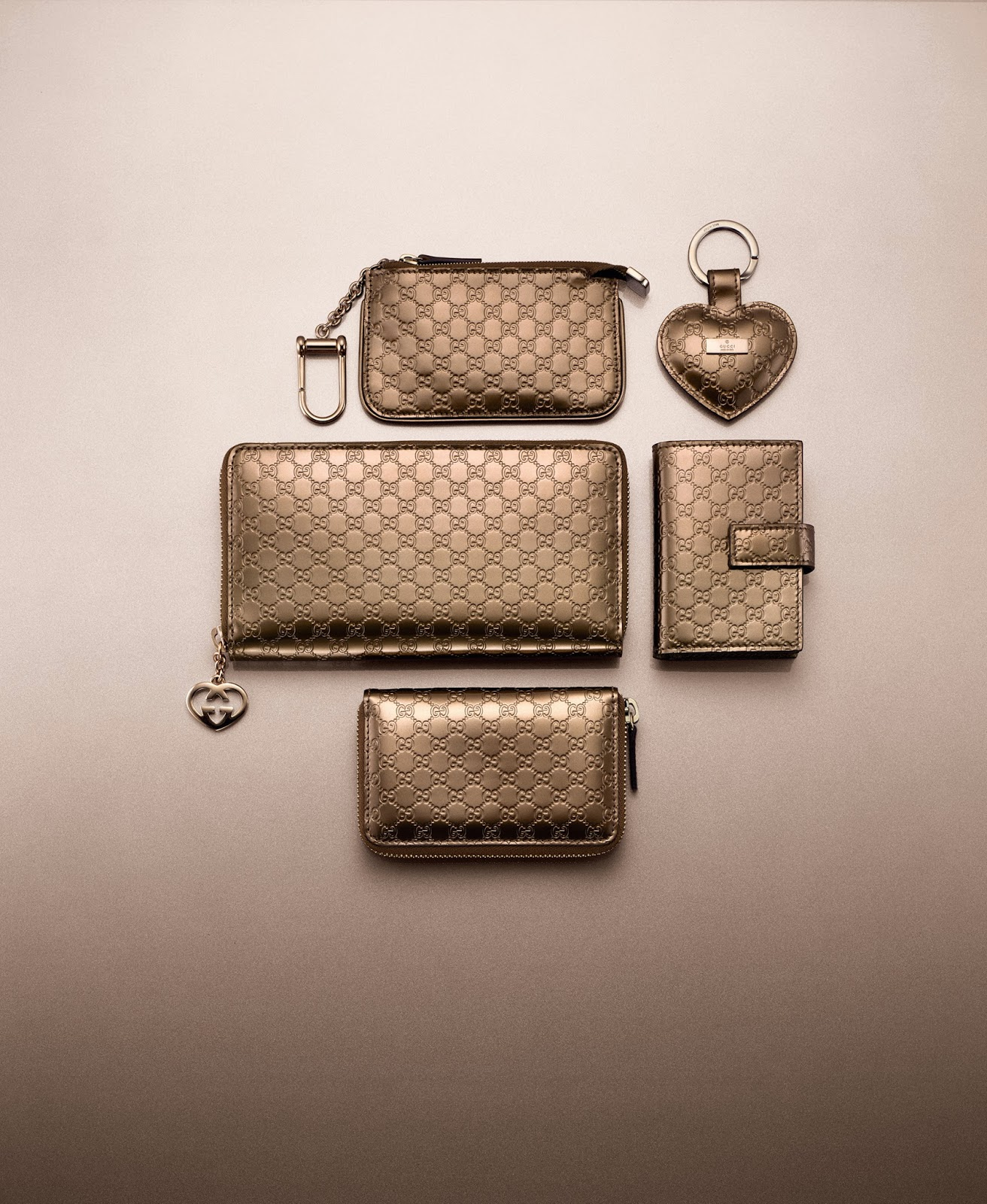 gucci key pouch. heart key fob rm540, zip-around card case rm800, rm1,040, zip around wallet rm2,080, pouch price upon application gucci k