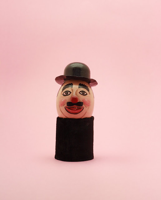 Clown Egg in front of pink background