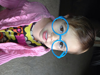 baby wearing silly glasses