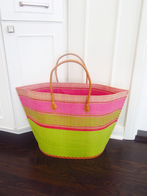 pink and green basket tote bag on kitchen floor