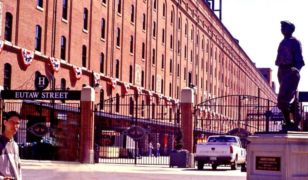 Eutaw St, Baltimore with statue of Babe Ruth and son Pete, both awaiting baseball