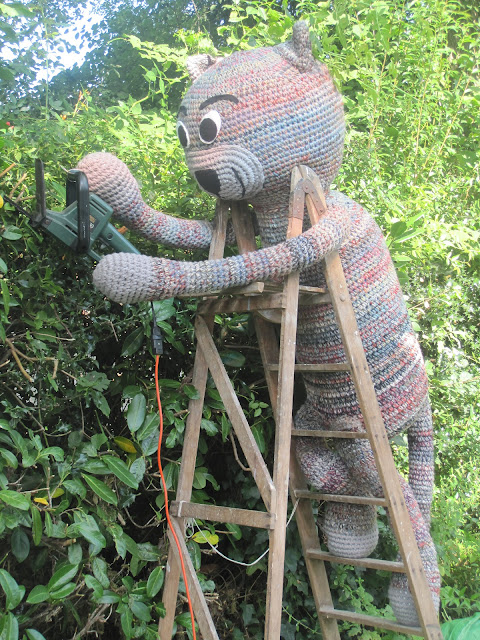 Fiddly Fingers Chester crochet cat hedge trimming up a ladder