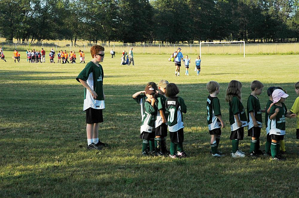 A large soccer field with children's teams.