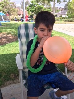 At the park, Adrian and his balloon