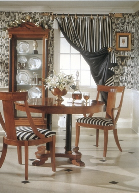 [A black-and-white room with cute striped curtains]