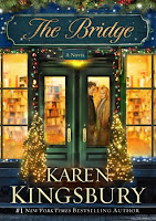 cover of The Bridge by Karen Kingsbury shows a well lit bookshop with a couple standing just inside the doors