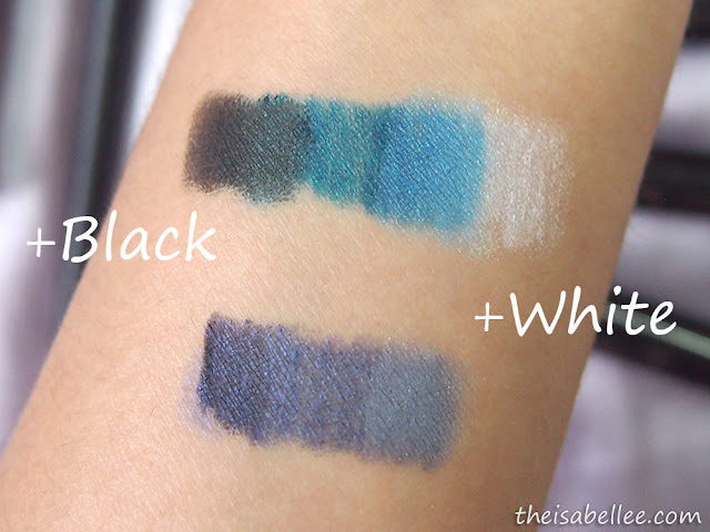 Layering black and white eyeshadows on top of other coloures