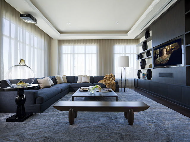 Photo of living room with dark furniture