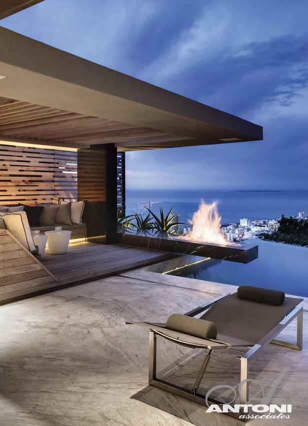 Terrace fireplace at Head Road 1843 by Antoni Associates