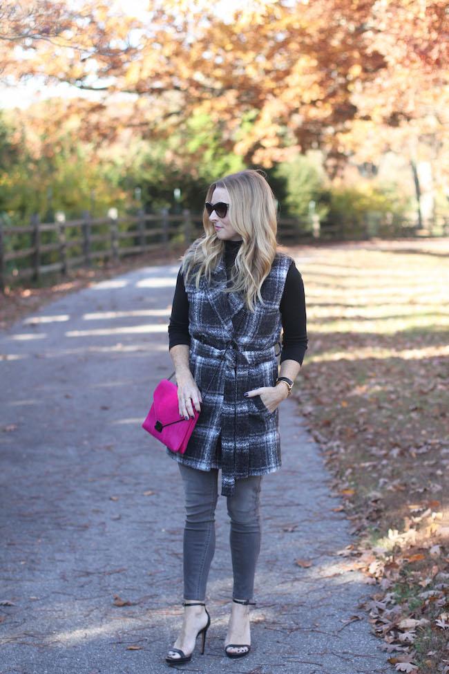 halogen turtleneck, wool vest, grey jeans, cat eye sunglasses, pink clutch