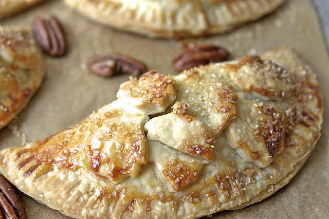 Caramel-Pecan Hand Pies - oh my word! These are crazy delicious and such a fun alternative to pecan pie.