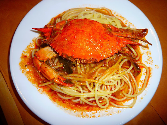 crabs cooking in fra diavolo sauce recipe follows at end of post