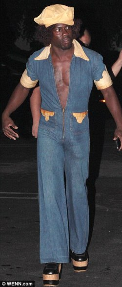 thats comedianactor kevin harts halloween costume he went back to the 1970s with flared trousers platform shoes an afro i know you see something hmm