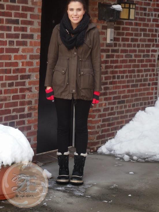 in the snow in Sorel Caribou Black