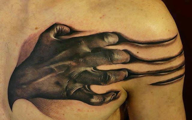 Realistic scratching hand tattoo on chest