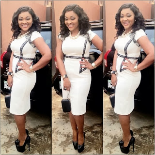 Exclusive Photoss from Mercy Aigbe 's wedding .
