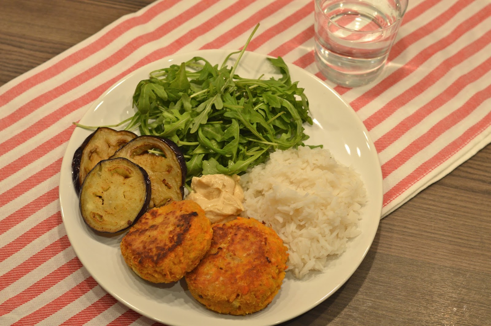 Sweet potato and chickpea cakes burgers patties vegetarian recipe serve with salad, humous, rice and fried aubergine