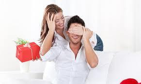 Valentine's Day On A Budget: 6 Ideas - woman surprising man with a gift present