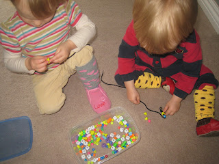 The Kids Stringing Beads