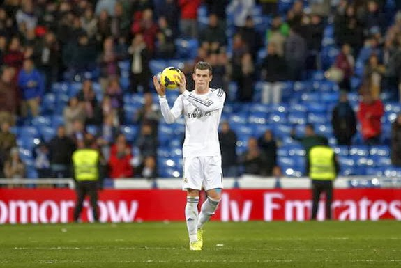 Real Madrid player Gareth Bale shows off the ball at the end of a match against Real Valladolid