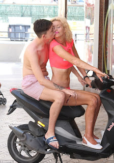 Transgender TV star Lauren Harries shares a kiss with her boytoy during romantic holiday in Spain (Photos)