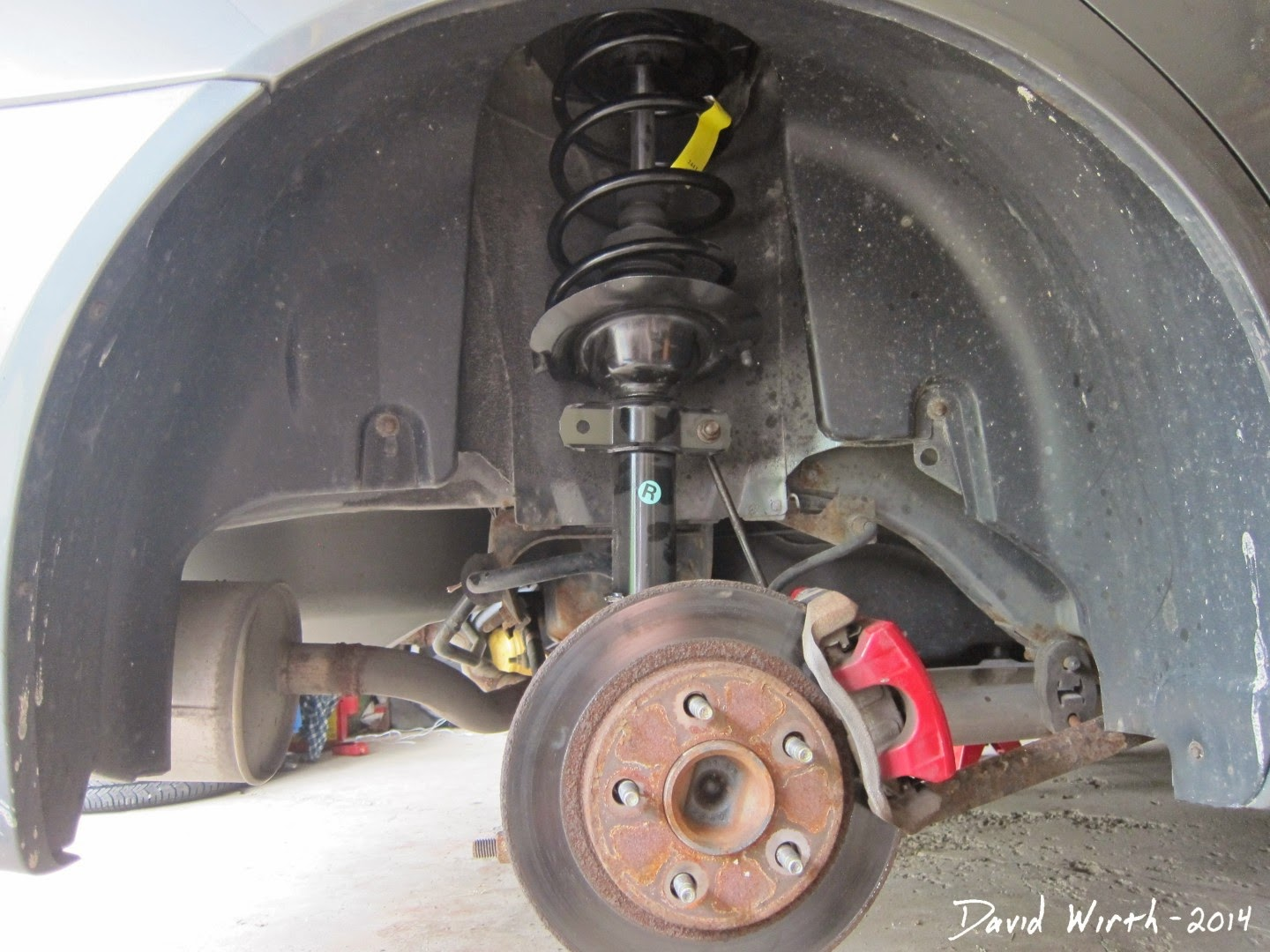 install new struts, pontiac grand prix, rear monroe struts, shocks