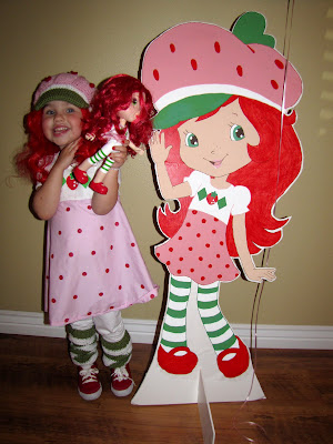 Here she is with her life-size Strawberry.