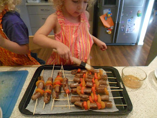 Sausage skewers and lemony couscous