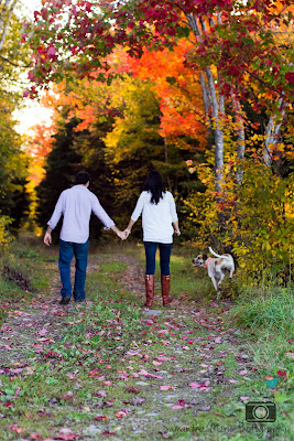couple walking on path with their dog