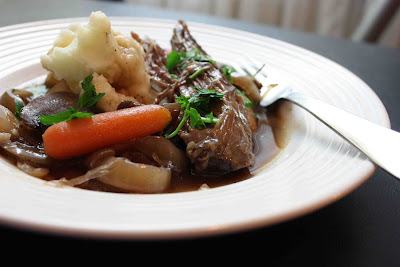 Slow Cooker Pot Roast Recipe with Red Wine and Brandy from Tasty Eats at Home found on SlowCookerFromScratch.com