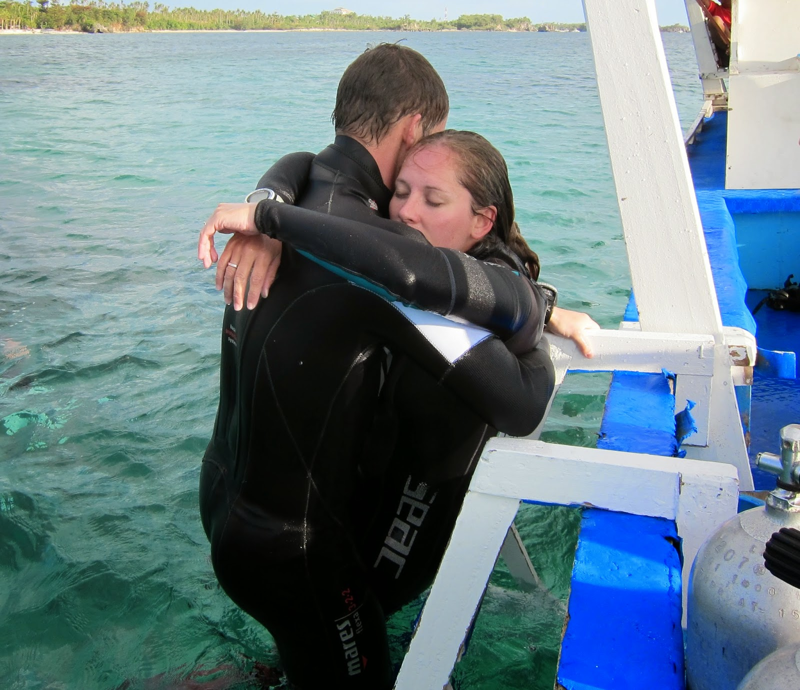Padi Rescue diver student Patrick lifts unresponsive diver, Kathy from the water in Malapascua, Philippines