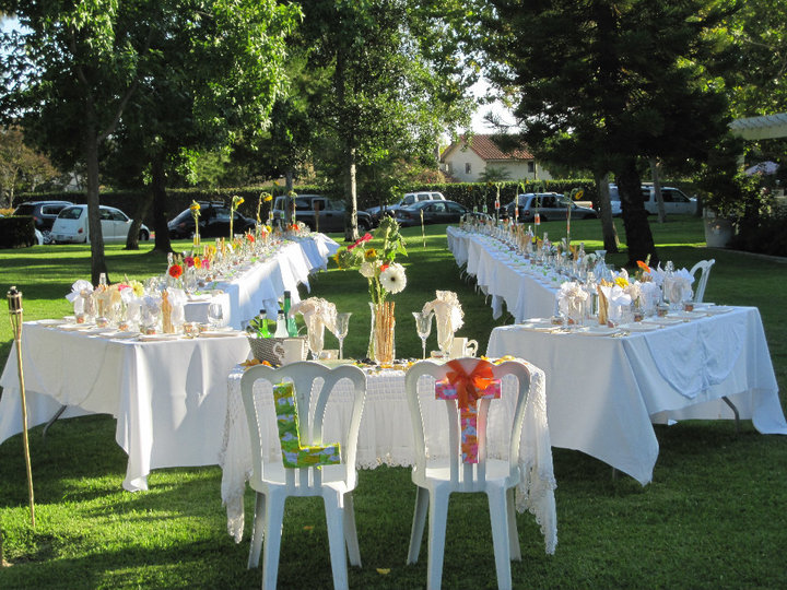 Two Long Tables Stretch The Length Of The Green Belt, With Two Smaller  Tables For The Wedding Party And Their Guests. The Bride And Groom Have ...
