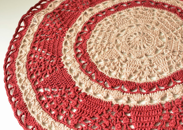 Crocheted doily in wine and beige colors