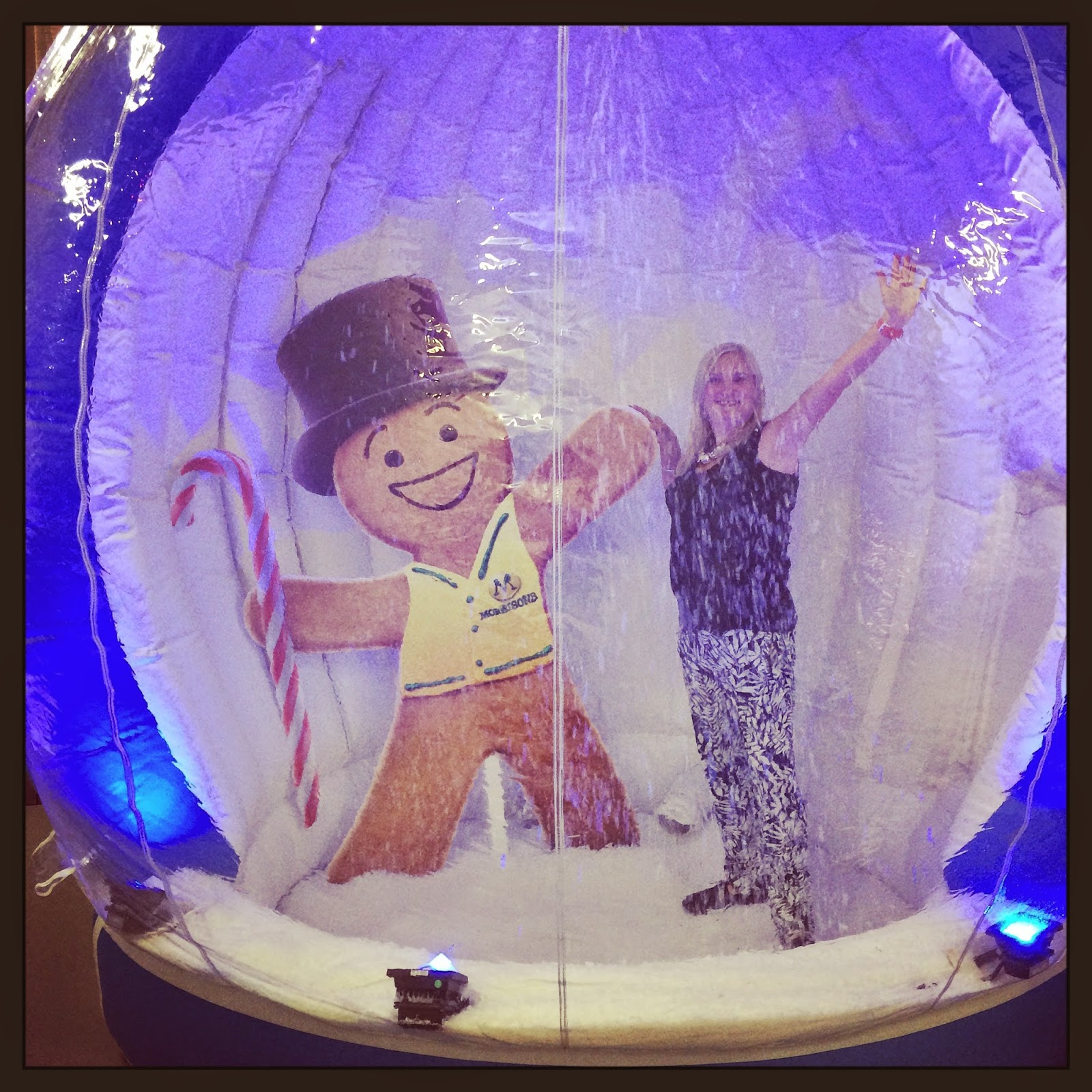 Ginger and blogger madmumof7 in snowglobe at Morrisons Christmas event