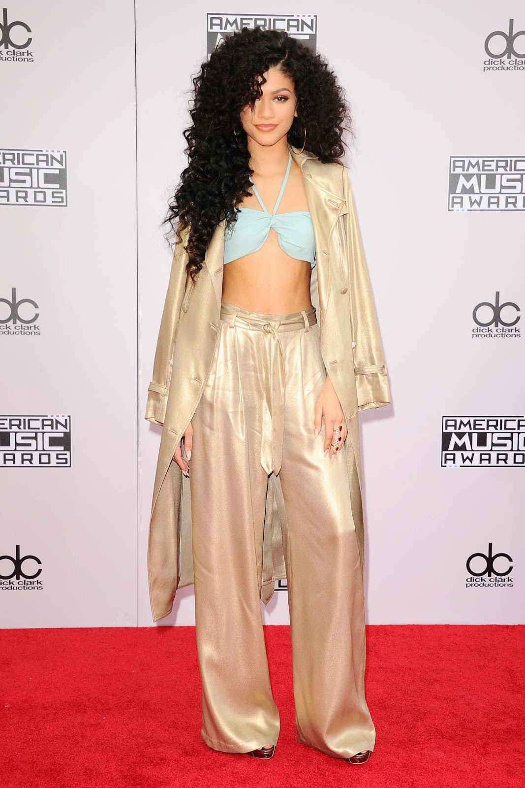Zendaya Coleman in a metallic gold trench and mint green bralet at the 2014 American Music Awards