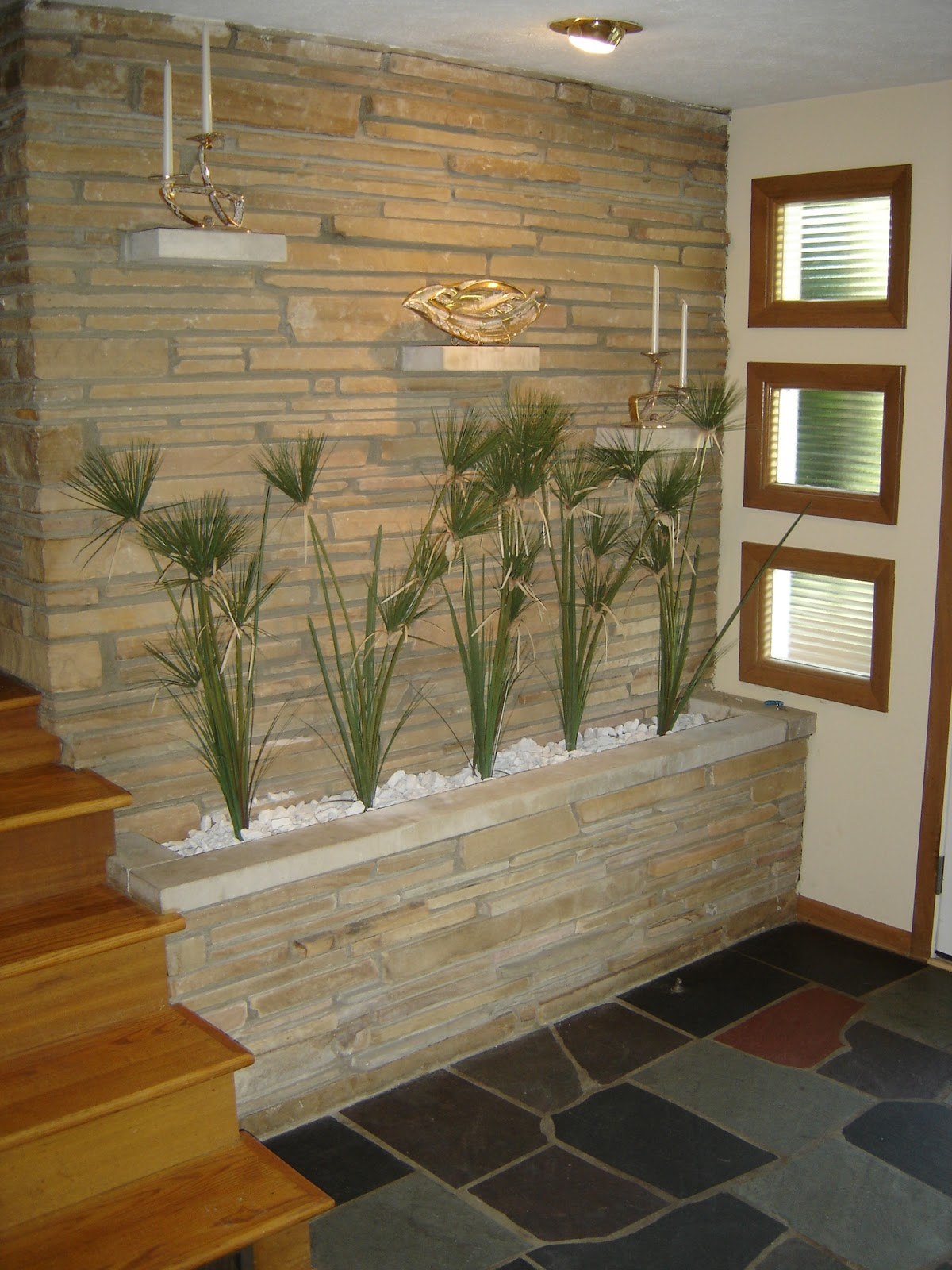 wonderful stone wall of the entry (and fireplace in the living room  title=