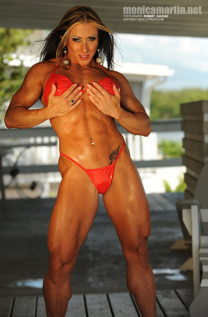 Monica Martin Flexes Her Abs And Built Quads In A Red Bikini