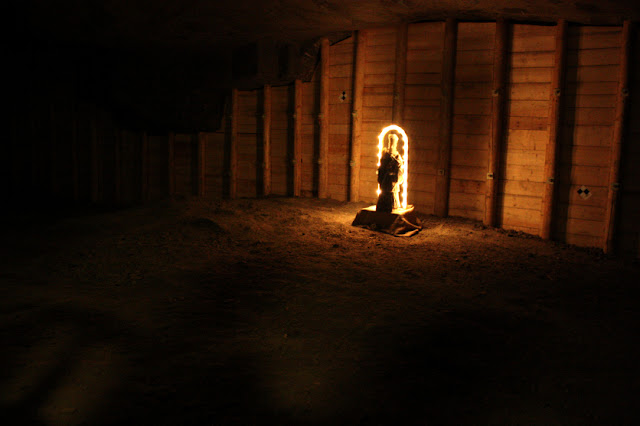 Dark room  with salt sculpture lit up in lights