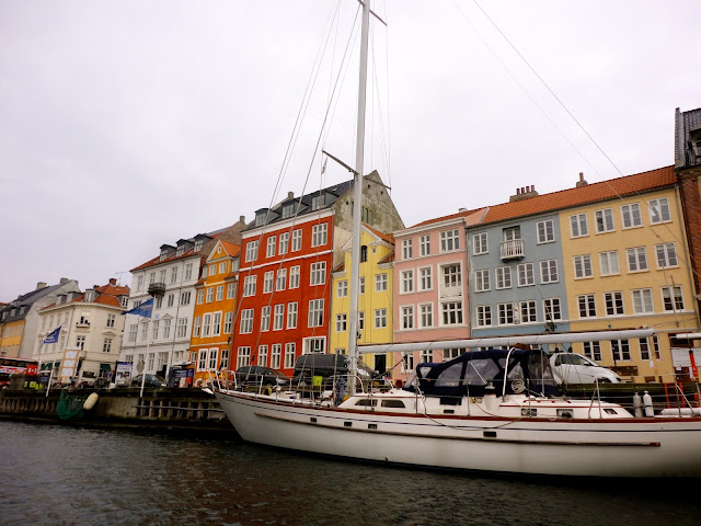Colourful houses and boats in the harbour at Nyhavn, Copenhagen, Denmark