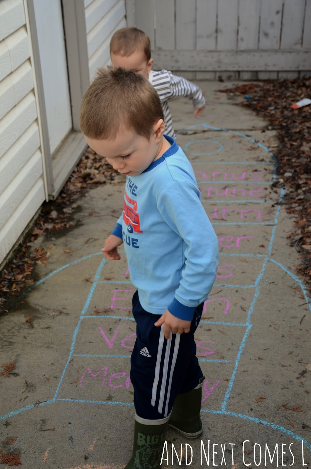 Playing rocket hopscotch and learning about planets from And Next Comes L
