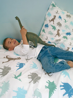 Children's Bedding - Fred the Dog Dino Duvet Set. Featured in a child's room.