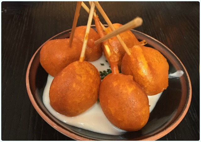 Fried chorizo lollipops