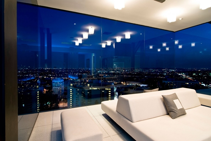 Glass wall in living room of Hollywood Mansion by Whipple Russell Architects