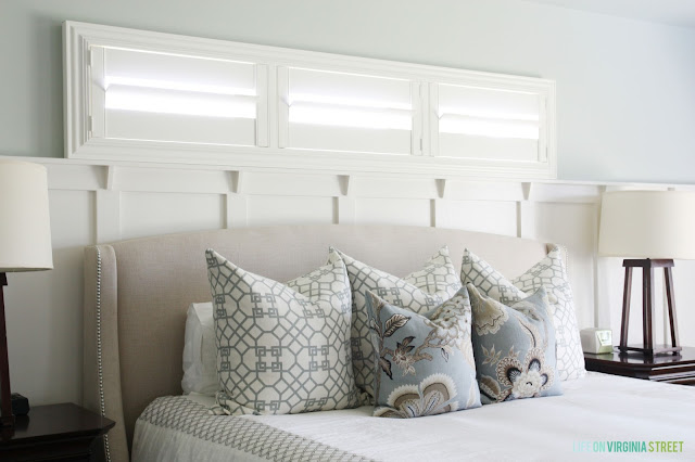 Gorgeous master bedroom with linen wing bed, sea salt walls and designer pillows