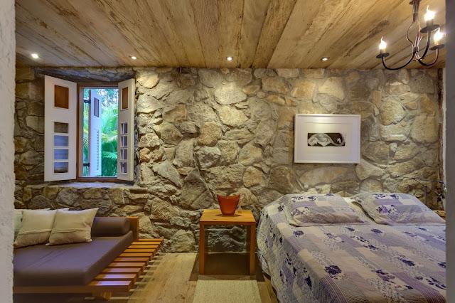 Como decorar dormitorios con paredes de piedra gu a y - Piedra para decorar paredes interiores ...