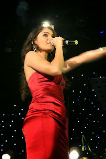 Andrea Jeremiah Singing a Song in Red Short Dress