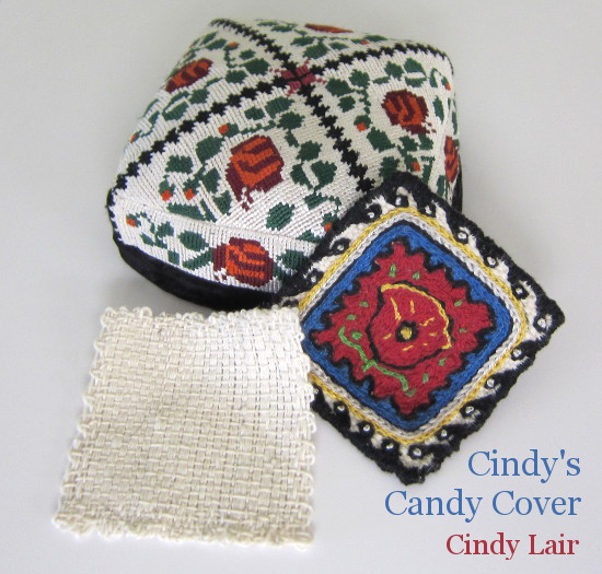 Picture of embroidered cap and zoom loom square.