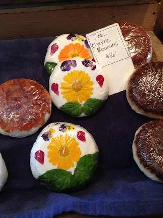 Little goat cheese disks decorated with edible flowers.