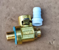 Fumoto oil drain valve with hose adapter